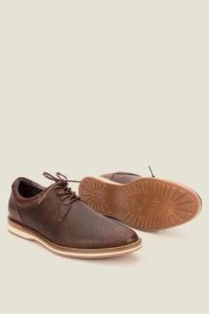 Zapatos storia de cuero