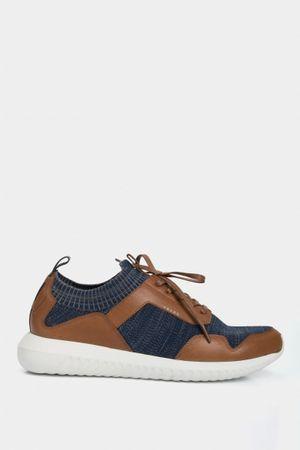 Sneakers deportivos de cuero para hombre tejido en capellada